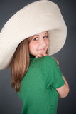 Nice girl in a big straw hat Royalty Free Stock Photography