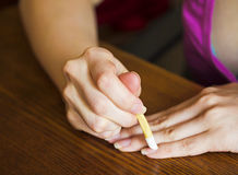 Cuticle treatment fingers the stick cuticle in the home Stock Photography