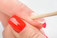 Cuticles care with cuticle pusher Royalty Free Stock Photography