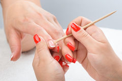 Cuticles care with cuticle pusher Stock Image