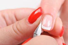 Cuticles cutting with nail clippers Stock Photography
