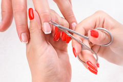 Cuticles cutting with scissors Stock Photos