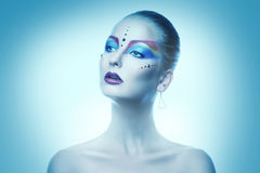 Cutie adult woman with colorful make up in cold tones. In studio Royalty Free Stock Image