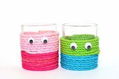 Cutie cups isolated. A couple of colorful decorated cups Stock Image
