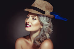 Cutie girl with beautiful makeup and stylish hat smiling Royalty Free Stock Images