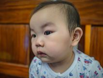 Cutie and handsome asian boy baby or infant make a face like interested. With something stock images