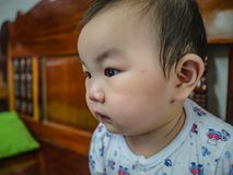 Cutie and handsome asian boy baby or infant make a face like interested. With something stock photography