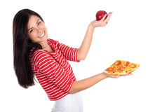 Cutie juggles with apple and pizza. Cute brunette juggles with apple and piece of pizza Royalty Free Stock Images