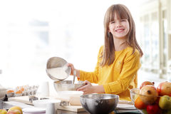 Cutie little girl at the kitchen Stock Photos