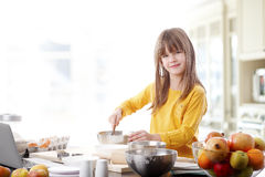Cutie little girl at the kitchen Stock Images