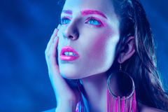 Cutie woman with pink make up looking up Stock Image