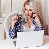 Cutie young blonde girl working on laptop Stock Photo