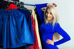 Cutie young blonde gitl in clothing store Royalty Free Stock Images