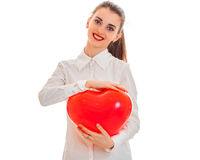 Cutie young brunette girl posing with red heart isolated on white background. Saint Valentines Day concept. Love concept Stock Image