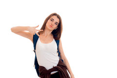 Cutie young brunette student with backpack and books in her hands posing on camera isolated on white background Stock Images