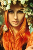 Cutie young redhair lady looking at camera with hop on head Royalty Free Stock Images