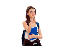 Cutie young students girl with blue backpack on shoulder and folders for notebooks in hands posing isolated on white.  Royalty Free Stock Photography