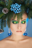 Cutie young woman with xmas tree-wreath on head and nice makeup Stock Photography
