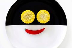 Cuties玉米和微笑辣椒 库存照片
