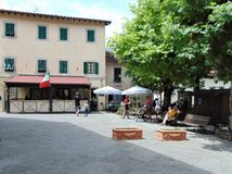 Cutigliano, Tuscany, Italy, central square of the town with tourists. Cutigliano, Tuscany, Italy, June 16th, 2019, view of the central square of the town with royalty free stock images