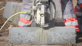 Cuting a concrete block stock footage