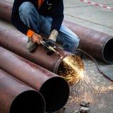 Cuting pipe Stock Image