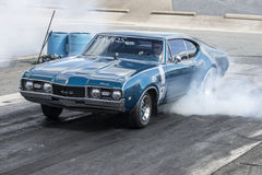 Drag racing. Sanair september 6-7, 2014 picture of oldsmobile cutlass 442 making a burnout at the starting line during festidrag event Stock Image