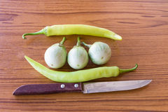 Cutlass,Eggplant, pepper on the table. Cutlass,Eggplant, pepper on the red table Stock Photo