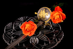 Cutlass and roses. Isolated over a black background Stock Photo