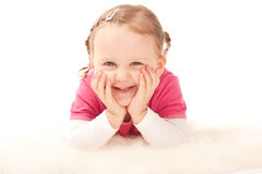 Cutle little girl is smiling on the floor Royalty Free Stock Photography