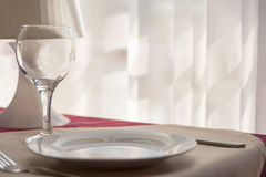 Cutler - glass, plate, fork on the table Royalty Free Stock Photography