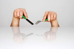 Cutlery. Hands holding knife and fork royalty free stock images