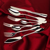 Cutlery. On smooth red background Stock Photography