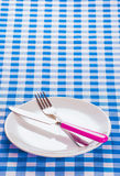 Cutlery on blue checkered background Stock Image