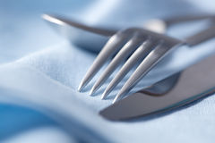 Cutlery on Blue Linen Stock Photography