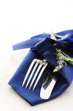 Cutlery with Blue Napkin Royalty Free Stock Image