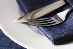 Cutlery with Blue Napkin on White Plate Royalty Free Stock Photography