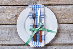 Cutlery with bow on plate. Stock Image