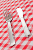 Cutlery on checkered tablecloth Royalty Free Stock Photography