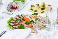 Cutlery and cold cuts served on festive table in restaurant Stock Images
