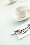Cutlery and cup Stock Images