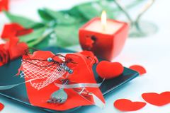 Cutlery on dark plate with a candle decorated for Valentine`s day Stock Images