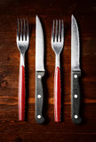 Cutlery  on dark wooden table. Top view Stock Image