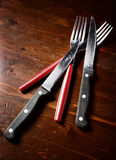 Cutlery  on dark wooden table. Top view Royalty Free Stock Photo