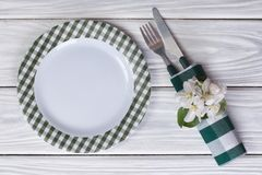 Cutlery decorated with flowers of apple on a table. Stock Images