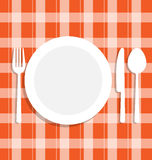 Cutlery dish on orange tablecloth Royalty Free Stock Images