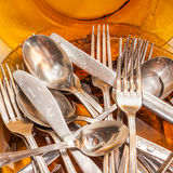 Cutlery and dishware washed under a water stream Royalty Free Stock Photography
