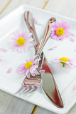 Cutlery and flowers Stock Photo