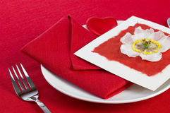 Cutlery with flowers on a red tablecloth.  stock photos