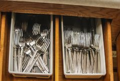 Forks inside kitchen drawer stock photos